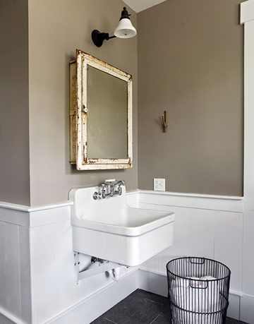 taupe and white bathroom with vintage medicine cabinet
