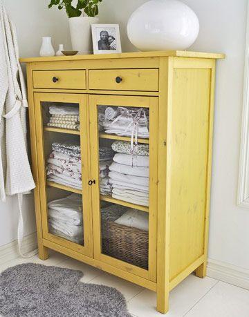 yellow linen cabinet