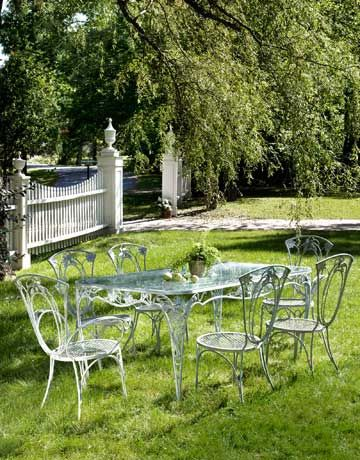 wrought iron outdoor furniture vintage iron patio furniture rh countryliving com vintage cast iron patio furniture vintage iron patio tables