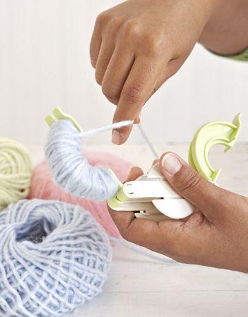 yarn on a pom pom maker