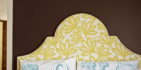 love pillows on bed with yellow floral headboard