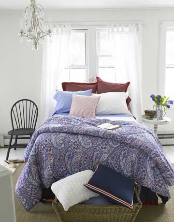 bed with paisley blanket