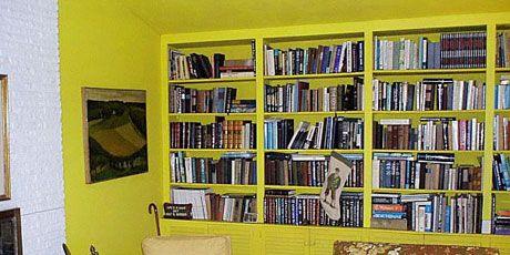 yellow living room bookshelves