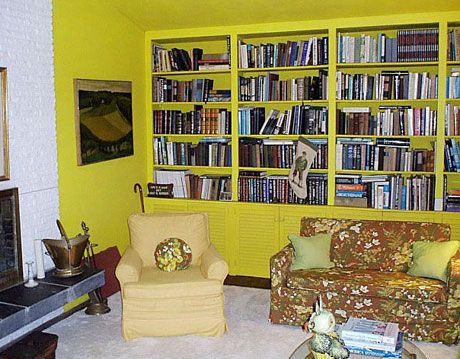 yellow living room bookshelves