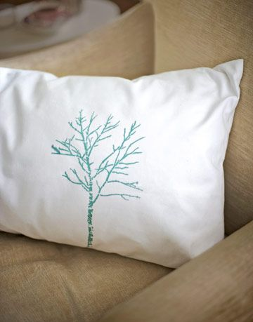 white pillow with aqua tree stencil