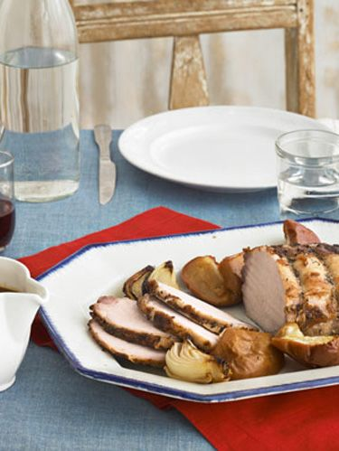 cider brined pork roast with onions and apples