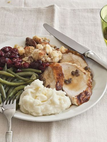 butter roasted turkey with gravy cornbread stuffing and mashed potatoes