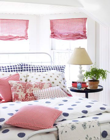 bedroom with polka dot pillows and sheets