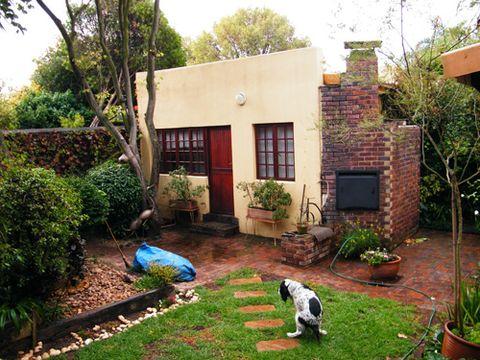 Plant, Property, Flowerpot, Garden, Shrub, Real estate, House, Building, Residential area, Home,