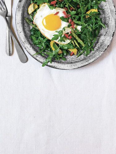 wild arugula with summer squash asparagus and a fried egg