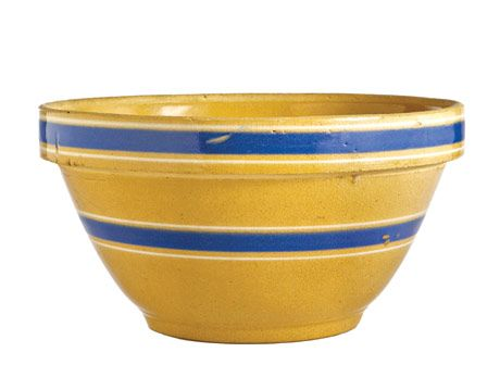 yellow bowl with two thick blue stripes