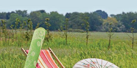 striped sling chair, green run, parasol and pillows