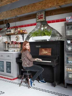 woman sitting at piano