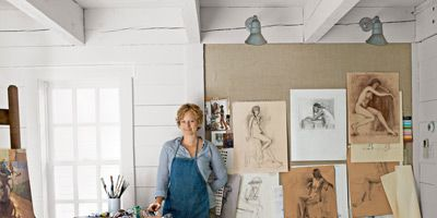 woman next to painting supplies
