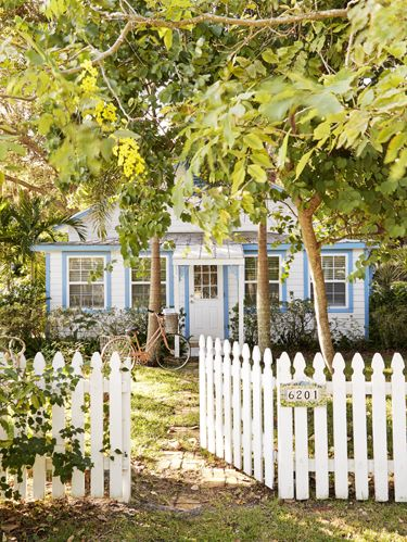 Picket fence, Window, Property, House, Leaf, Home fencing, Real estate, Home, Residential area, Woody plant,