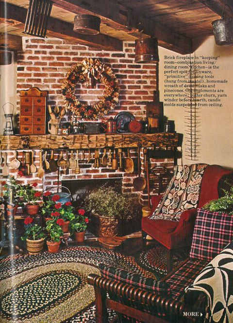 The Room Featuring Primitive Cooking Tools A Homemade Wreath Of Dried Husks And Pinecones Old Implements Like Er Churn Candle Molds Hanging