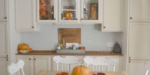 Room, Orange, Serveware, Squash, Table, Home, Vegetable, Pumpkin, Interior design, Dishware,