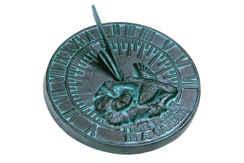 cast iron sundial of hummingbird with flower and roman numerals