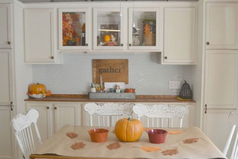 Room, Orange, Serveware, Squash, Table, Home, Vegetable, Pumpkin, Interior design, Dishware,