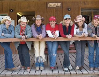 group of women in cowboy hats