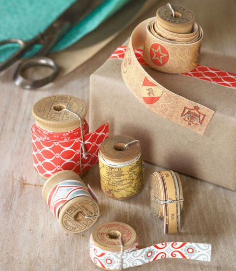 thread spools with paper wrapped around them