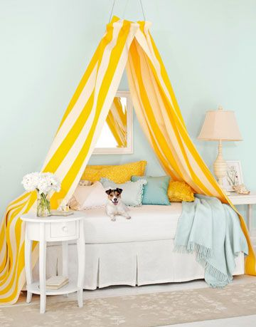 yellow and white canopy bed