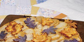 sliced potato dish with leaf cutouts