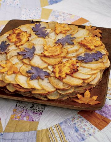 sliced potato dish with leaf cutouts