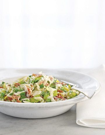 orzo with ricotta bacon and leeks in white bowl