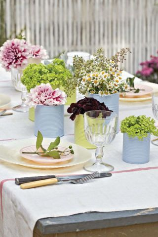 table setting with flowers in vases