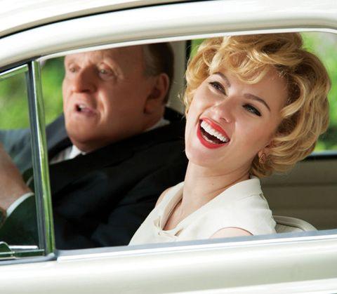 Motor vehicle, Nose, Mouth, Automotive exterior, Vehicle door, Automotive mirror, Glass, Tooth, Eyelash, Luxury vehicle,
