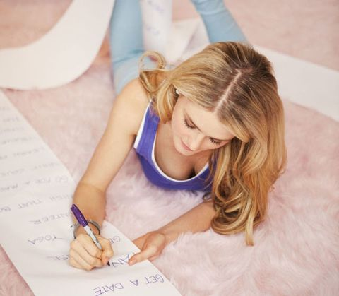 Finger, Hairstyle, Hand, Pen, Wrist, Writing implement, Nail, Stationery, Long hair, Writing,