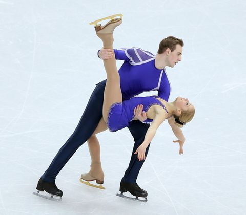 Ice skate, Hand, Knee, Ice rink, Thigh, Figure skate, Athletic dance move, Figure skating, Dance, Skating,