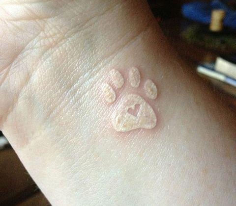 Skin, Joint, Tan, Symbol, Close-up, Tattoo, Flesh, Religious item, Cross, Temporary tattoo,