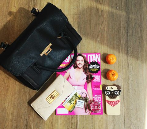 Bag, Fashion accessory, Waist, Abdomen, Luggage and bags, Leather, Shoulder bag, Advertising, Material property, Wallet,