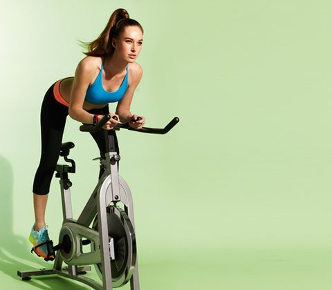 Indoor cycling, Stationary bicycle, Exercise machine, Human leg, Elbow, Joint, Physical fitness, Exercise, Exercise equipment, Bicycle frame,