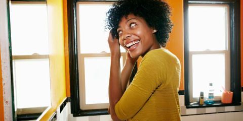 Shoulder, Happy, Jheri curl, Tooth, Elbow, Fixture, Black hair, Afro, Laugh, Ringlet,
