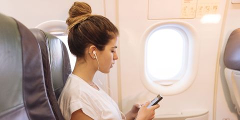 Hairstyle, Skin, Comfort, Shoulder, Joint, Sitting, Air travel, Fashion accessory, Bridal accessory, Aircraft cabin,