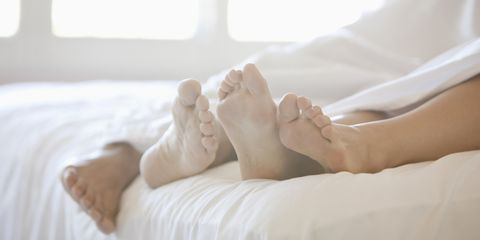Comfort, Toe, Human leg, Textile, Barefoot, Linens, Foot, Bed, Bedroom, Sole,