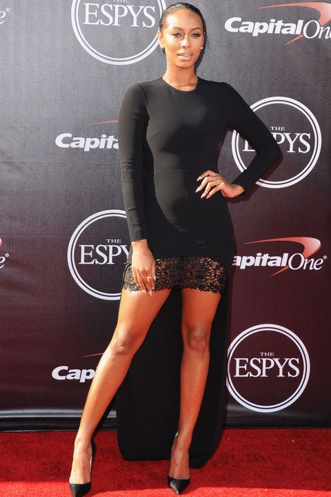 Dress, Sleeve, Flooring, Shoulder, Joint, Human leg, Carpet, Style, Premiere, High heels,