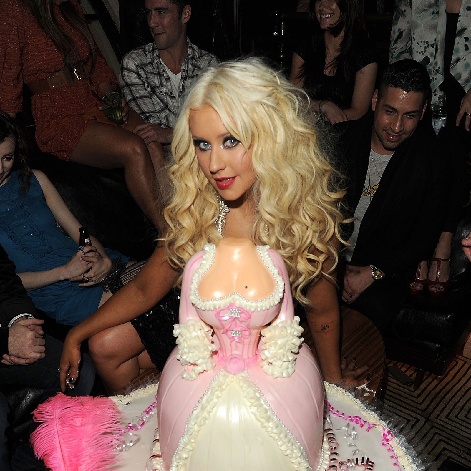 Christina Aguilera poses with her birthday cake.