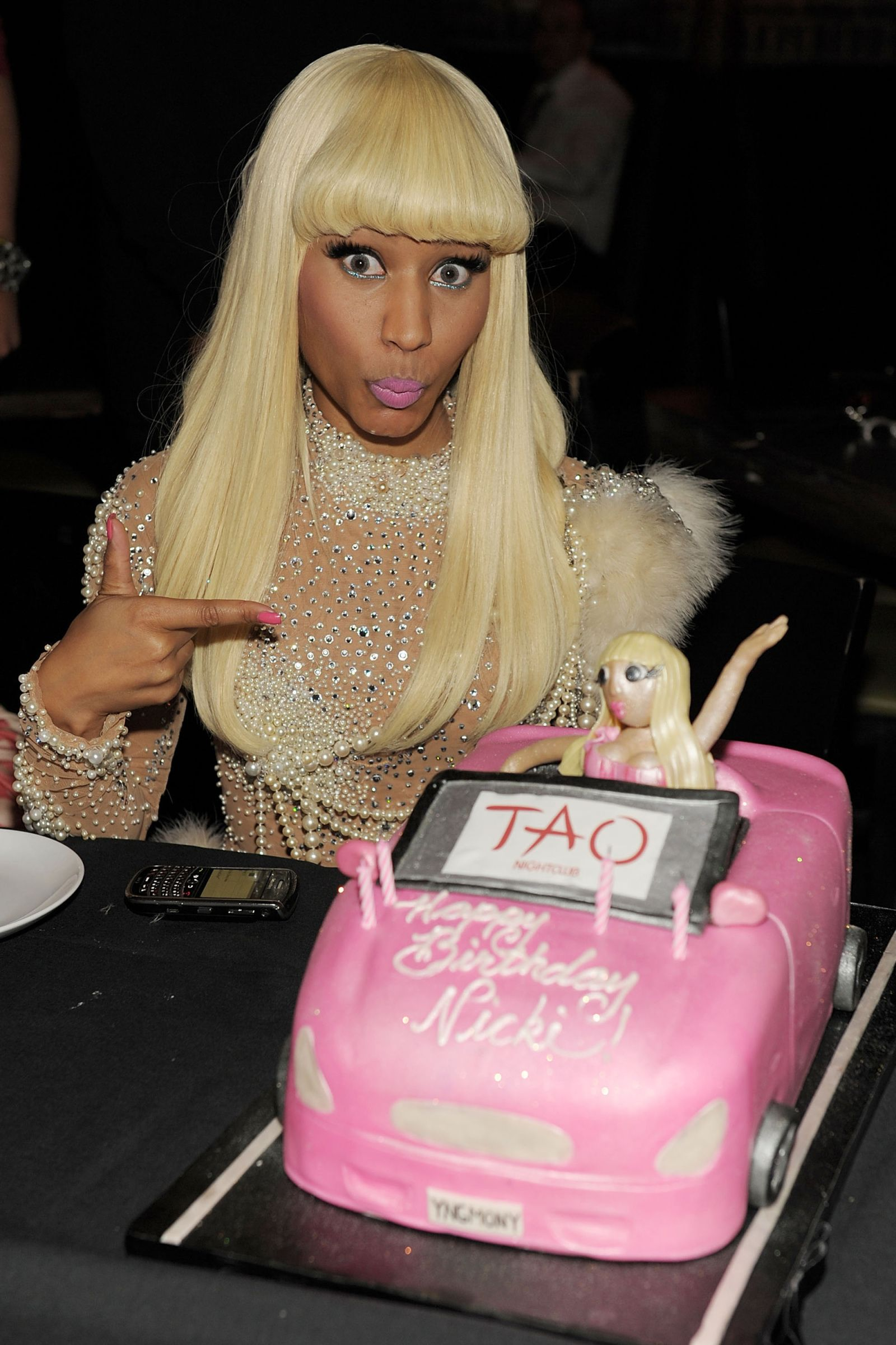 Nicki Minaj poses with her birthday cake.