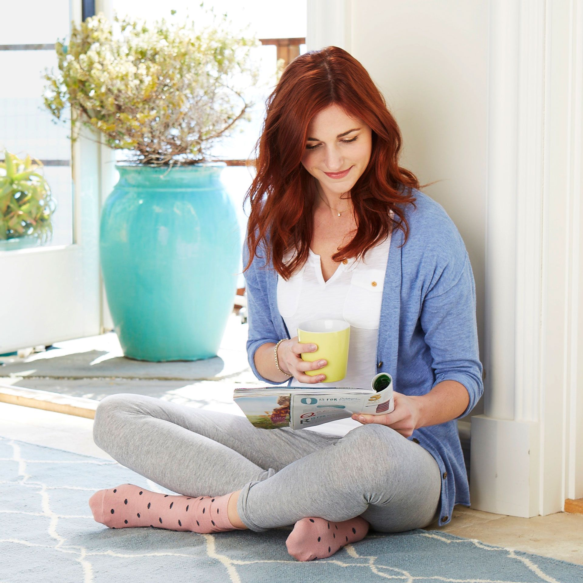 <p>Find a comfortable spot on the floor and sit with a wall behind you. (Magazine and coffee optional.)</p>