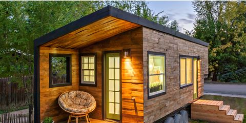 """<p dir=""""ltr""""><span>This 196-square-foot house near Boise, Idaho, is home to Macy Miller, her partner James, their daughter Hazel, and their Great Dane, Denver. A 27-year-old architect, Macy designed the home from scratch and built it on a 24-foot flatbed with help from friends and family. Clad in siding made of recycled pallet wood, the minimalist home is flooded with light and feels spacious despite its size. Hidden storage under the bed, above the pantry, and behind the fridge are contrasted with open shelving in the kitchen to make the space feel bigger. In total, Macy spent about $11,000 on her tiny house and is now able to live rent- and mortgage-free.</span></p> <p dir=""""ltr""""><a href=""""http://minimotives.com/pro-photos/"""" target=""""_blank"""">Find out more about Macy's tiny house</a>.</p> <p>&nbsp;</p>"""