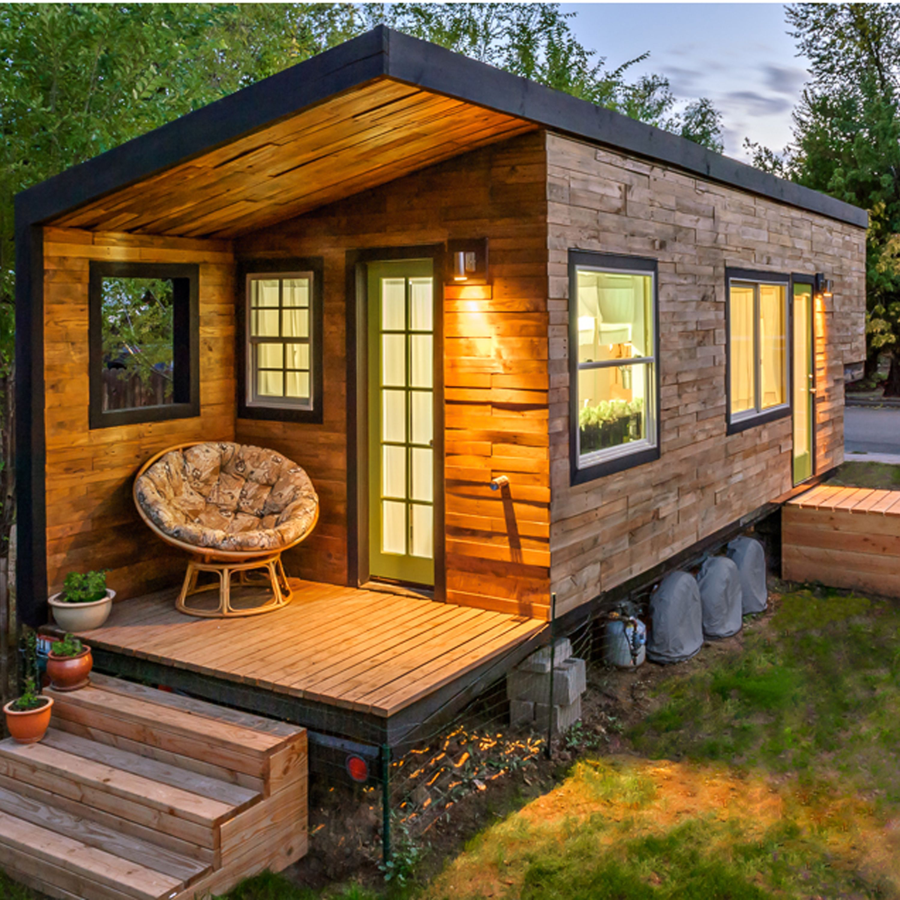 """<p dir=""""ltr""""><span>This 196-square-foot house near Boise, Idaho, is home to Macy Miller, her partner James, their daughter Hazel, and their Great Dane, Denver. A 27-year-old architect, Macy designed the home from scratch and built it on a 24-foot flatbed with help from friends and family. Clad in siding made of recycled pallet wood, the minimalist home is flooded with light and feels spacious despite its size. Hidden storage under the bed, above the pantry, and behind the fridge are contrasted with open shelving in the kitchen to make the space feel bigger. In total, Macy spent about $11,000 on her tiny house and is now able to live rent- and mortgage-free.</span></p><p dir=""""ltr""""><a href=""""http://minimotives.com/pro-photos/"""" target=""""_blank"""">Find out more about Macy's tiny house</a>.</p><p>&nbsp&#x3B;</p>"""