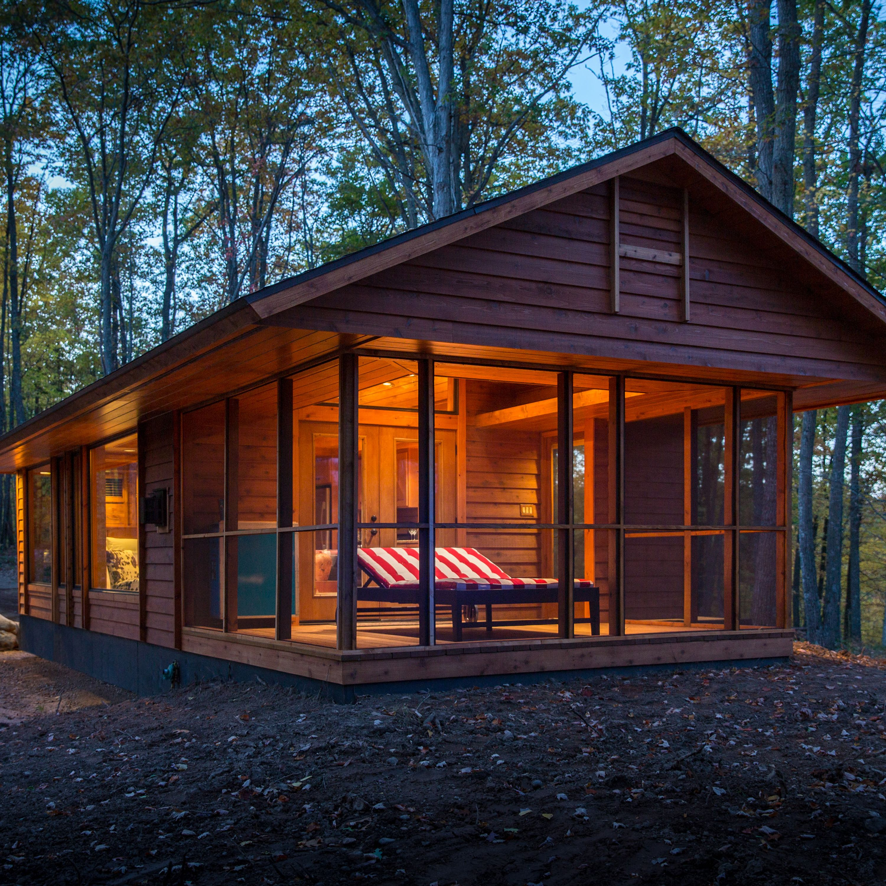 """<p dir=""""ltr"""">Inspired by and built by the team responsible for the gorgeous cottages at the <a href=""""http://www.canoebay.com/"""" target=""""_blank"""">Canoe Bay&nbsp&#x3B;resort</a> in the woods of Wisconsin, the 392-square-foot Escape looks like a high-end cabin but is actually a 28- by 14-foot Park Model RV on wheels. Vaulted ceilings and a large window wall give an airy feel to the cottage, which includes a living room with fireplace and kitchen wall and a separate bedroom and bath. Large French doors open to a screened porch that can be used as an extended living room, sleeping porch, or a dining area. The red-striped chaise lounge doubles as a bed with heated coils, perfect for naps on chilly days. Escape is available to rent at Canoe Bay, or can be custom-built for buyers and delivered ready to live-in. Prices start at $79,900.</p><p dir=""""ltr""""><a href=""""http://www.escapehomes.us/"""" target=""""_blank"""">Find out more about Escape</a>.</p>"""