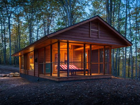 "<p dir=""ltr"">Inspired by and built by the team responsible for the gorgeous cottages at the <a href=""http://www.canoebay.com/"" target=""_blank"">Canoe Bay&nbsp;resort</a> in the woods of Wisconsin, the 392-square-foot Escape looks like a high-end cabin but is actually a 28- by 14-foot Park Model RV on wheels. Vaulted ceilings and a large window wall give an airy feel to the cottage, which includes a living room with fireplace and kitchen wall and a separate bedroom and bath. Large French doors open to a screened porch that can be used as an extended living room, sleeping porch, or a dining area. The red-striped chaise lounge doubles as a bed with heated coils, perfect for naps on chilly days. Escape is available to rent at Canoe Bay, or can be custom-built for buyers and delivered ready to live-in. Prices start at $79,900.</p> <p dir=""ltr""><a href=""http://www.escapehomes.us/"" target=""_blank"">Find out more about Escape</a>.</p>"