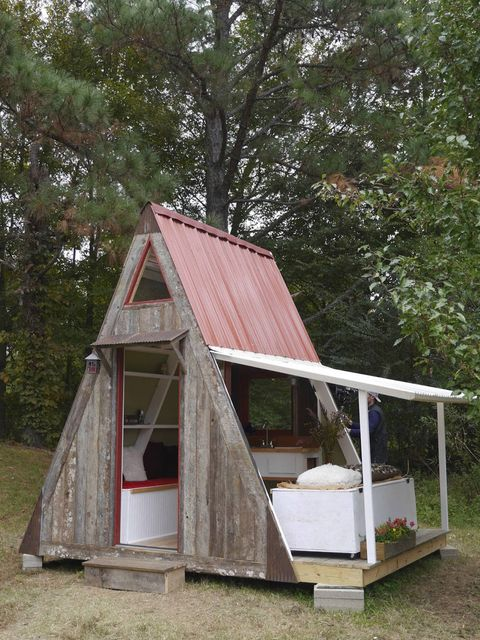 "<p dir=""ltr"">Designed by Derek &#147;Deek&#148; Diedricksen of <a href=""http://www.relaxshacks.blogspot.com"" target=""_blank"">RelaxShacks.com</a>&nbsp;and built by Joe Everson of <a href=""http://www.TennesseeTinyHomes.com"" target=""_blank"">Tennessee Tiny Homes</a>, this transforming micro A-frame cost only $1,200 to construct. One roof/wall is made of Tuftex polycarbonate roofing: Not only is it translucent to allow in natural light, the lightweight material is attached to the structure with hinges so it easily can be raised and propped on legs to expand the space from 80 square feet to 110. On the other side of the A, the purlins supporting the roof sheathing are placed horizontally to serve double duty as shelves. Two daybeds house massive amounts of storage, a kitchen wall features a sink and space for a mini fridge, and a micro loft has a hinged &#147;sunroof&#148; for ventilation. Architect duo David and Jeanie Stiles drafted the plans for this A-frame, which are on sale for $30.&nbsp;</p> <p dir=""ltr""><a href=""http://www.relaxshacks.blogspot.com/2014/02/deek-david-stiles-and-joe-everson-team.html"" target=""_blank"">Find out more about the transforming A-frame</a>.</p> <p dir=""ltr""><a href=""https://www.youtube.com/watch?v=fWQ8begkTAQ&list=UUoYe2YOpqspuGAOB1Epe7GA"" target=""_blank"">See a video of the A-frame in action</a>.</p>"
