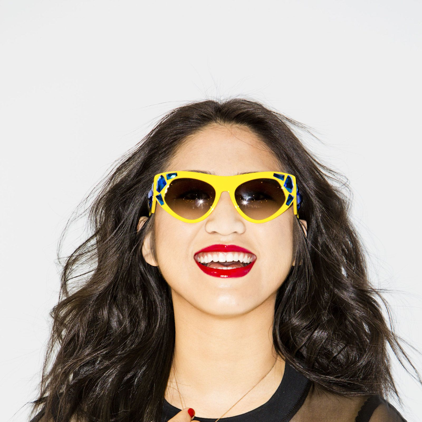 "<p>Art-history major. ""When I wear red lipstick, it reminds me of Atlanta because everyone has red UGA Bulldogs and Braves tee shirts.""</p><p>Top, Ostwald Helgason, $540. Sunglasses, Prada, $430. Necklace, Diane Kordas. All other jewelry, Shannon's own.</p>"