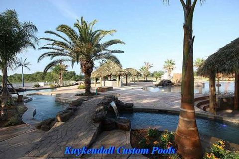 Body of water, Plant, Tree, Arecales, Woody plant, Resort, Tropics, Water feature, Flowering plant, Palm tree,